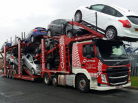 Car transporter moving multiple vehicles