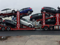 Car transporter truck moving multiple cars at once