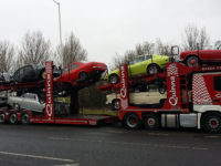 Car transporter carrying multiple classic cars